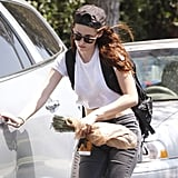 Kristen Stewart carried a coffee.