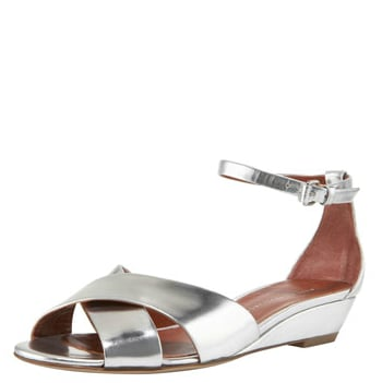 Add a flash of metallic to your casual or event wear with this ultraversatile pair.  Marc by Marc Jacobs Low-Wedge Ankle-Wrap Sandal ($260)