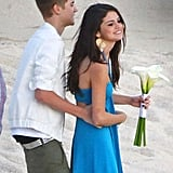 Former couple Selena Gomez and Justin Bieber looked so happy at a friend's wedding in Mexico in December 2011.