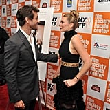 Lizzie and Hugh chatted on the carpet.