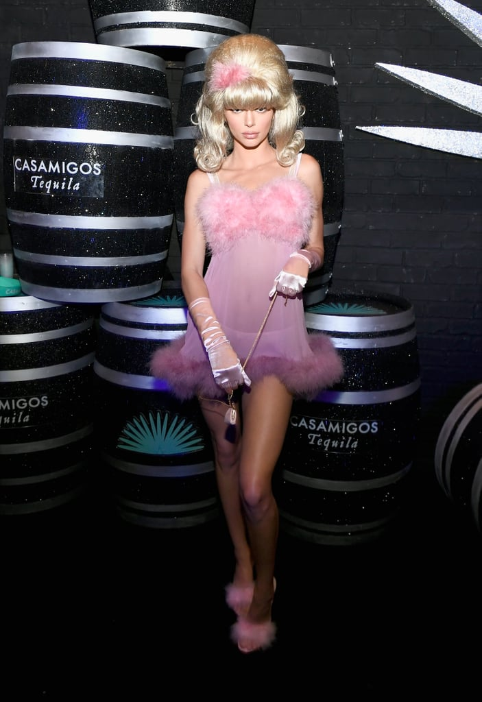 Just when you think her Halloween costumes can't be topped, Kendall Jenner breaks out another outfit that's sure to impress all over again. The 22-year-old model celebrated Halloween a little early at the Casamigos party in Las Vegas on Saturday, and she drew some inspiration from the world of Austin Powers for her bombshell costume. Kendall sported a spot-on Fembot look for the party, choosing a sheer pink babydoll nightgown with feather detailing and matching heels. She paired the look with the tiniest bag we've ever seen, plus an enormous blonde wig and silky gloves. Ahead, her look from all angles. Something tells us this isn't the last costume we should expect from Kendall this year.