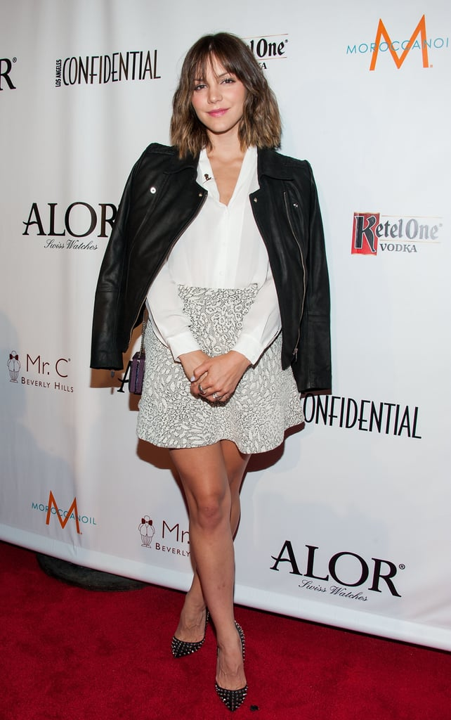 At the LA Confidential pre-Emmys kickoff celebration in LA, Katharine McPhee tucked a white blouse into a printed miniskirt, then threw on a black leather jacket and studded pumps.