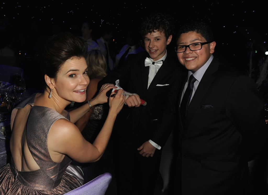 Breaking Bad's Betsy Brandt signed Nolan Gould's cast at the 2013 Emmys Governors Ball.