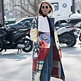A Patchwork Coat, Simple Black Jumper, Jeans, and Black Boots