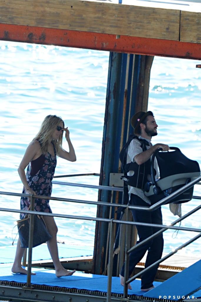 Tom Sturridge and Sienna Miller carried Marlowe Sturridge onto a boat in her carrier.