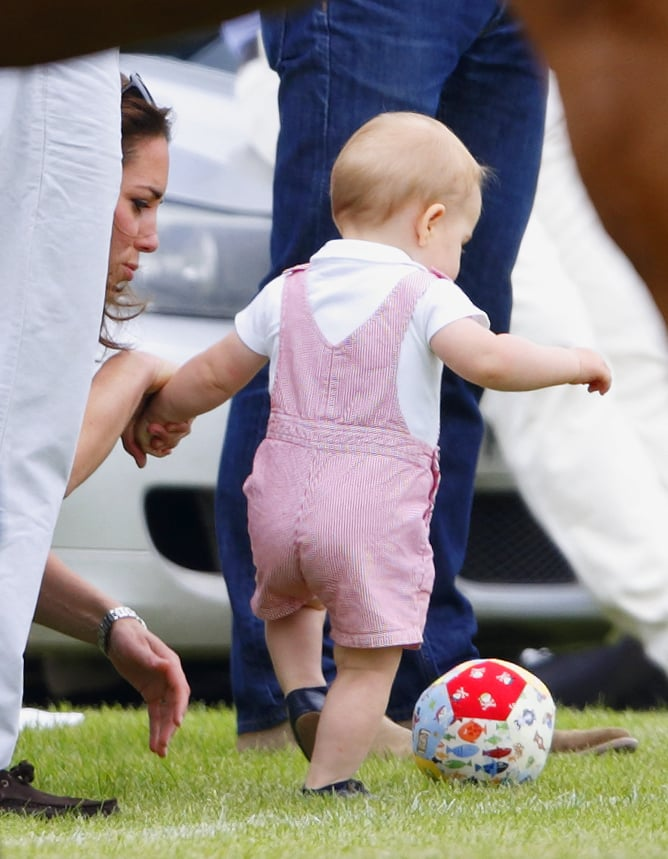 World Cup fever is in full force as fans — and stars! — around the globe cheer on their favorite teams. There are plenty of kids showing their spirit, and we have to think one famous little guy in particular is also getting in on the craze. Prince George showed off his soccer skills during a charity polo match last month, so it's safe to say he's a fan of the sport (perhaps he takes after his sporty mom, Kate Middleton?). He may not be able to root for the England national team, since the UK lost to Costa Rica while his uncle Prince Harry was visiting Brazil last week, but he still looks cute kicking around a soccer ball.