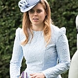 Princess Beatrice also chose to pin her badge to her clutch, to save ruining her textured dress.