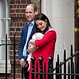 As Prince William looks into the crowd of people at the hospital, Kate gets lost in little Louis.
