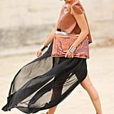 The juxtaposition between sheer fabrics and buttery leather stole the show in this ensemble.