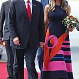 Melania kept the dresses coming during her tour of Poland and Germany in July 2017. She wore this graphic-print Delpozo midi with purple suede Manolo Blahnik heels.