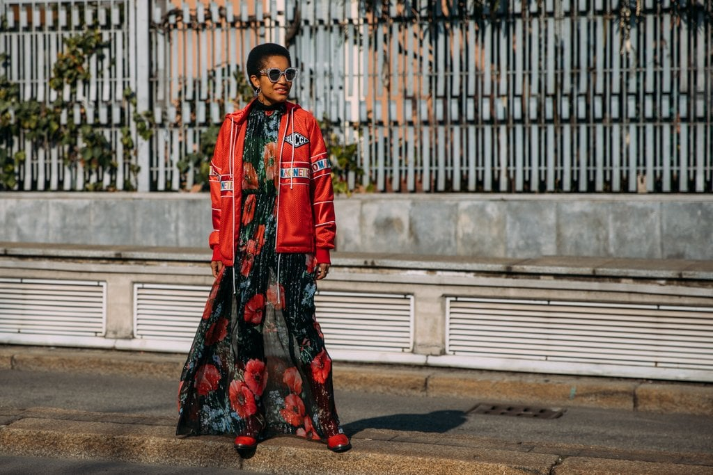 Tamu McPherson toughened up a floral dress with a sporty jacket.