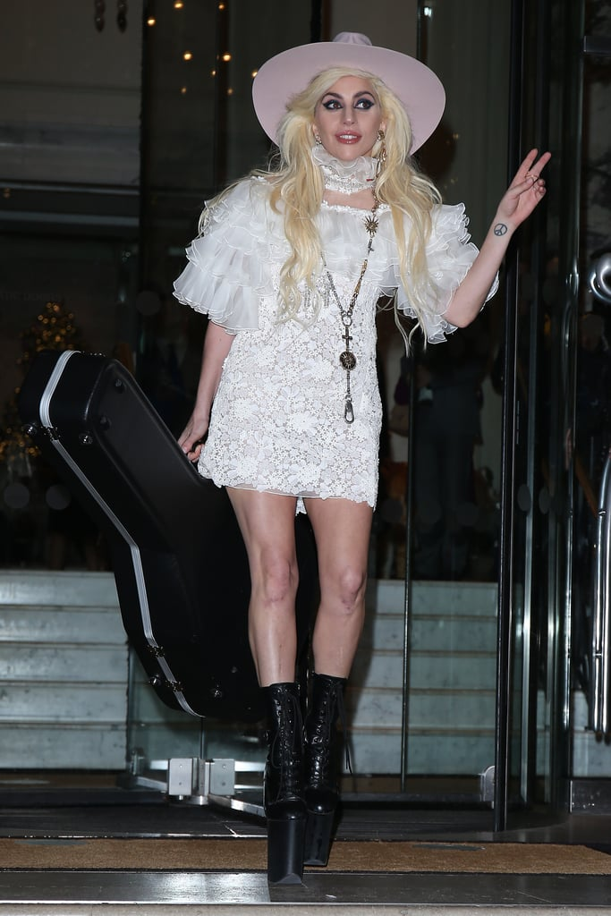 Wearing A White Lace Dress Black Pleaser Boots And A Pink Hat