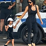 While Kim Kardashian styled her lace-ups with a simple black tank.
