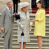 Pregnant Kate Middleton was a ray of sunshine in a bright yellow coat at a royal garden party hosted by Queen Elizabeth II at Buckingham Palace on May 22.