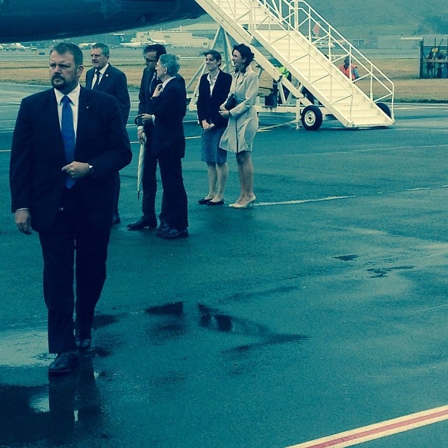 George's nanny (in the blue skirt) watched as Kate, Will, and the little prince disembarked from the plane in New Zealand. Source: Instagram user sperrypeoplemag