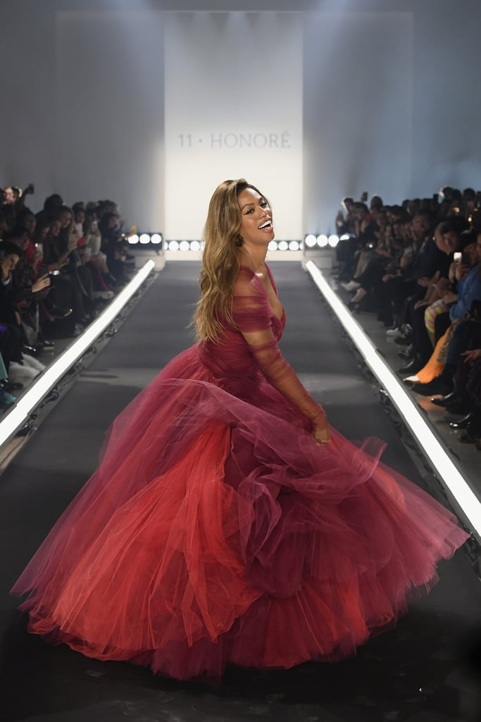 """New York Fashion Week started — and, truthfully, ended — with a twirl. On Feb. 6, size-inclusive shopping destination 11 Honouré hosted its first-ever runway show, with Laverne Cox leading the charge. Wearing a burgundy gown by Zac Posen, the actress spun down the runway while Robyn's """"Honey"""" thumped in the background. The exuberant runway moment is already being considered a highlight of the season and stood out in an industry that often faces criticism for taking itself too seriously. If the burgundy gown seems familiar, it's because Laverne isn't the first star to twirl in all of its tulle glory. Miley Cyrus wore the same design during her performance with Elton John at the 2018 Grammy Awards. The gown's designer was also in attendance at the award show, and Miley and Zac posed for several photos together backstage. Ahead, revel in the joyous Fashion Week moment and see pictures of the gown's previous appearance at the Grammys.      Related:                                                                                                           8 New Street Style Trends You Can Expect to See All Over Fashion Week"""