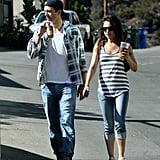 Ashton Kutcher and Mila Kunis enjoyed beverages while they walked around LA.