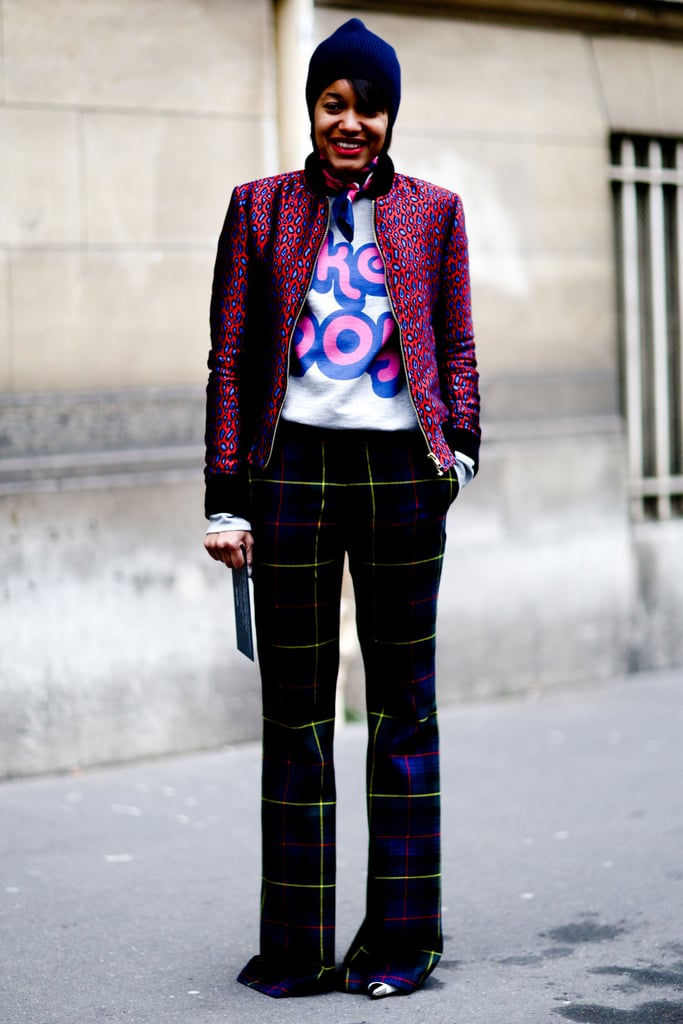 We love the punchy play between her plaid pant, printed jacket, and sporty sweatshirt.