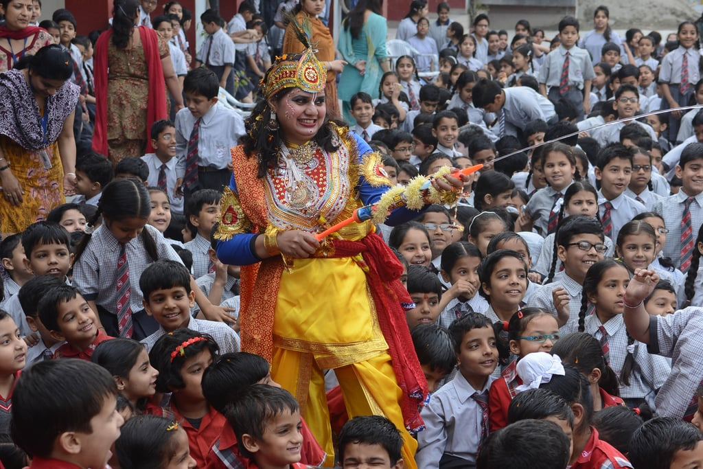 A School Teacher Dressed As Lord Krishna Used A Water Gun During Holi  Holi Pictures -8866