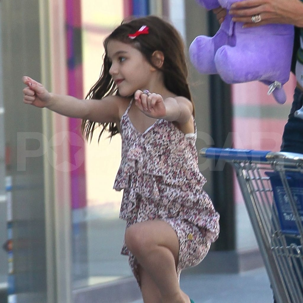 Suri Cruise is too cute skipping to her car!