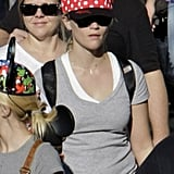 Reese Witherspoon in a Minnie Mouse hat.