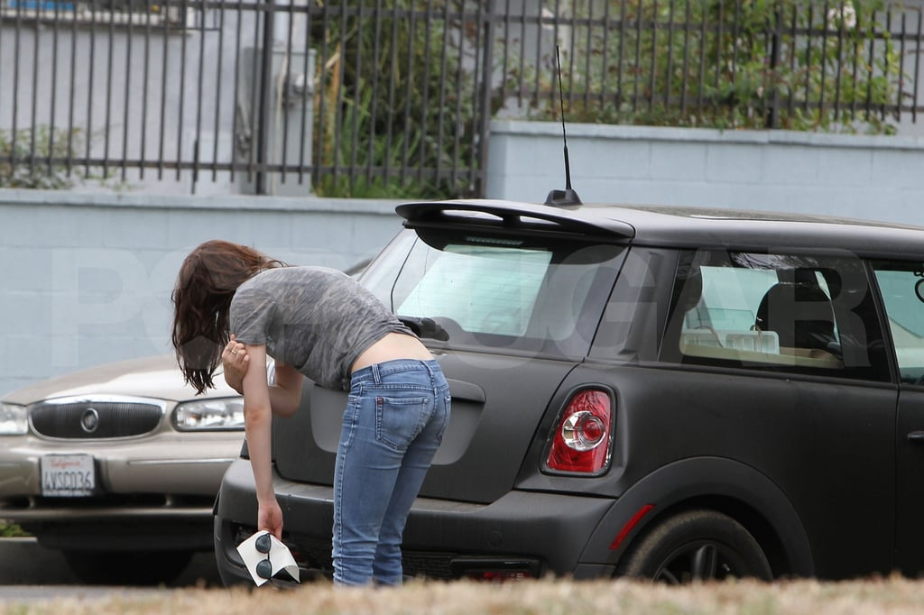 Kristen Stewart checks her car.