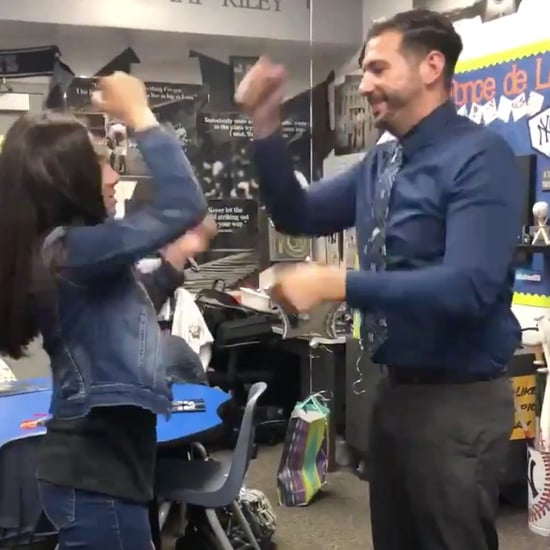 Student and Teacher Greet Each Other With Special Handshake