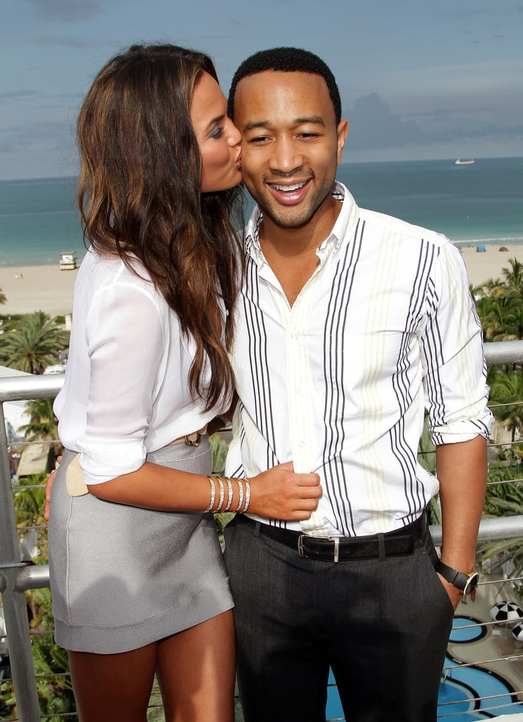 The couple posed in front of a beautiful backdrop during a Miami fashion show in July 2011.