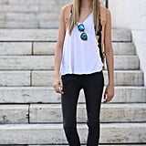 Cara Delevingne showed off her grungy-cool side with lace-up boots and mirrored shades. Source: Greg Kessler