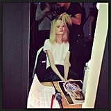 Model Hanne Gaby getting her hair and makeup done for Ellery.