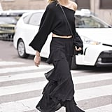 Let a raglan style crop top slip off one shoulder and play up the feminine vibes in ruffled pants.
