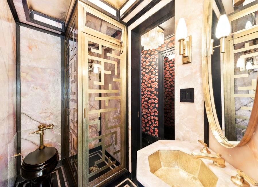 The bathroom is full of sexy touches and bold geometric prints. We have no doubt Cameron handpicked the stunning Ann Sacks glass tiles.