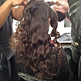 Once the hair cooled, the waves were let out for a gorgeous wave sans the curling iron. They were sprayed with hair spray again for hold, and then they were back-combed to create the gauzy-looking hair texture.