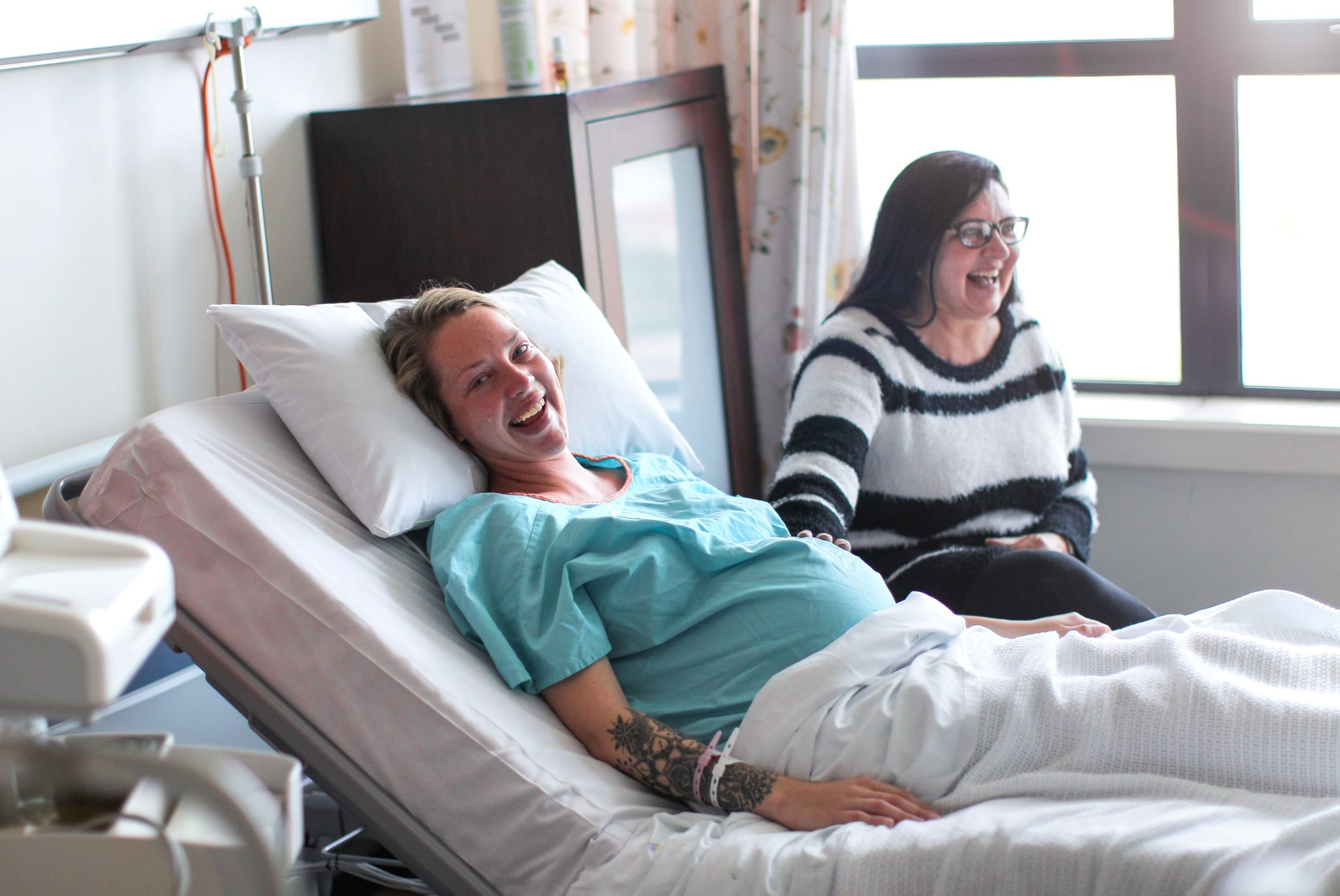 a Mother spends time with her pregnant daughter in hospital before she has a caesarean section.