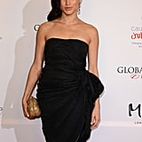 While in London in November 2013, Meghan opted for a strapless LBD, which she accessorized with a gold clutch.