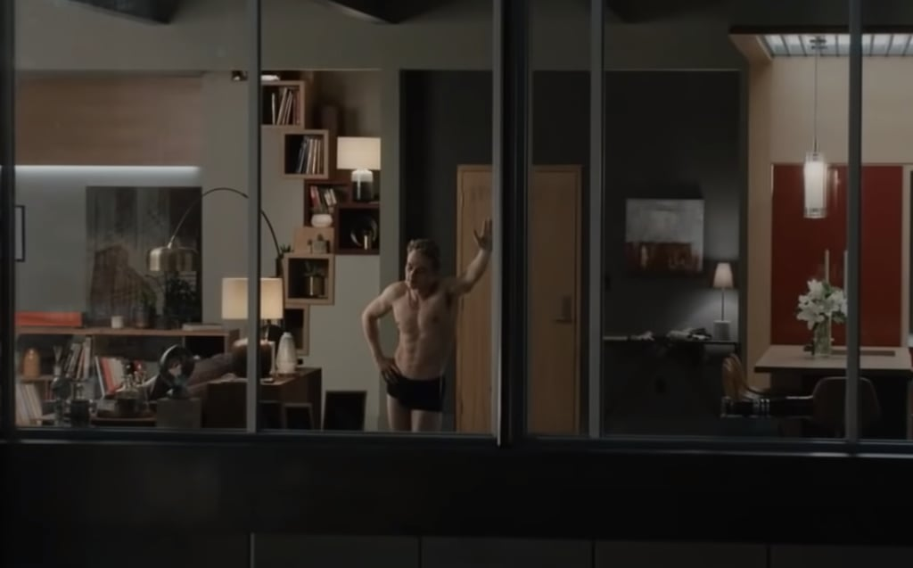 00:06:00 The NSFW scenes start off early in The Voyeurs when Pippa and Thomas spy their neighbors Seb and Julia having oral sex on their kitchen counter. The scene flicks back and forth between both couples until Julia and Seb's intimate moment becomes even more risqué and Pippa insists they look away. 00:15:25 Piquing Pippa's intrigue (and ours) even more, the camera pans slowly over Seb's shirtless torso until the pair make chilling eye contact and Pippa gasps, shattering a glass on the floor.  00:18:15 While Julia is away, Seb, who is a photographer, invites a model over and snaps topless photos of her. Pippa and Thomas, who recently invested in a pair of binoculars to get a closer look at their neighbors, watch as Seb seduces the woman and has sex with her from behind. As Thomas looks through the binoculars, Pippa asks him to describe what he sees and gives him a handjob. The scene gets even more heated when Pippa grabs the binoculars and asks Thomas to copy Seb. Thomas finishes quickly and Pippa stays on the couch to continue watching Seb.