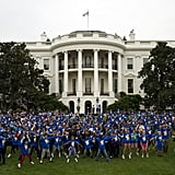 Michelle Obama leads local kids in jumping jacks.