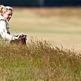 Lindsey Vonn snapped pictures of her boyfriend, Tiger Woods, while he played a practice round for the 142nd British Open Championship in Scotland.