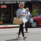 Katherine Heigl put the ultimate nautical spin on her Fendi Twins straw tote by pairing it with a striped boatneck top, skinny black pants, and ladylike flats.