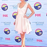 Taylor Swift wore a white Lucia Hohan dress, Prada pumps, and Edie Parker clutch.