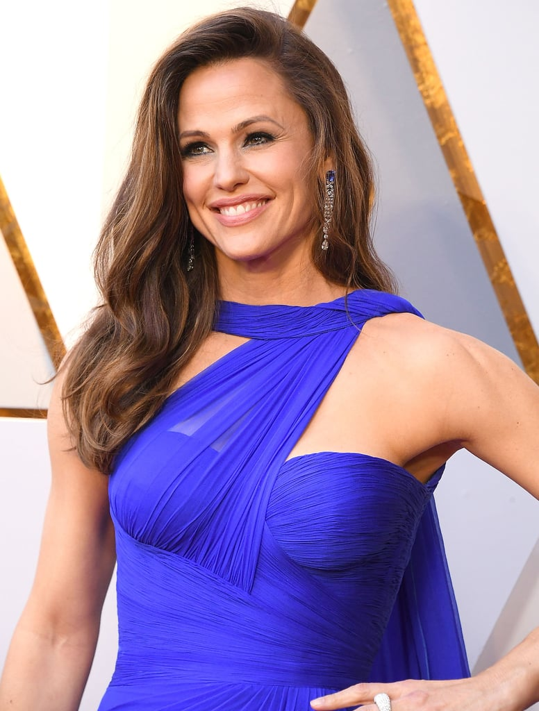 Jennifer Garner was exceptionally stunning at the Oscars this year, and it got us thinking about all of her past appearances at the big show. Jen first showed up at the Academy Awards in 2003 (she was starring in the series Alias at the time), and while she looked beautiful even back then, seeing her on Sunday night was a truly jaw-dropping experience. In 2018, Jen walked the red carpet looking like she stepped straight off a runway in Paris; her bright blue Atelier Versace gown hugged in all the right places, her hair and makeup was completely on-point, and those arms, you guys? We don't know if it's sleep, water, leafy greens, or singledom, but Jen — keep doing whatever you're doing, OK girl? Take a walk down memory lane with Jen's best Oscars photos.      Related:                                                                                                           What Was Jennifer Garner Thinking in This Oscars Reaction Shot? The Question Will Keep You Up