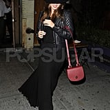 Miranda Kerr smiled on her way out of a restaurant.