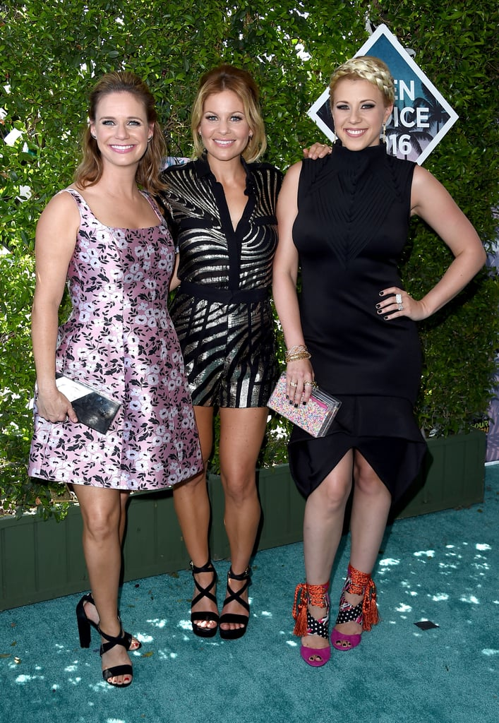 "Candace Cameron Bure, Andrea Barber, and Jodie Sweetin were all smiles while arriving together for the Teen Choice Awards in LA on Sunday. The actresses, who reprised their iconic TV roles for the Netflix reboot Fuller House last year, hit the red carpet and posed for photos in flirty dresses (and for Candace, a jumpsuit) and high heels. Fuller House picked up the award for choice TV comedy, while Candace nabbed a nod for choice TV actress in a comedy, thanks to her performance as DJ Tanner.  The trio is already back at work filming the show's second season, and have been sharing fun photos from the set. Candace recently revealed to POPSUGAR that viewers can expect more cameos: ""There are a lot of people that are really excited to be a part of this show,"" she told us, adding that an invitation still stands for Mary-Kate and Ashley Olsen, who played Michelle Tanner. ""We would love to have them,"" Candace said. ""I know everyone would love to see them."""