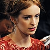 Actress Ahna O'Reilly embellished her braided hairdo with a golden headband that would be perfect for the boho bride.