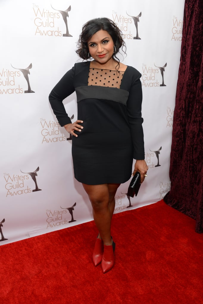 Mindy Kaling opted for a flirty polka-dot dress paired with red ankle boots and a black Chanel clutch.
