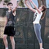 Nicholas pretended to block her shot.