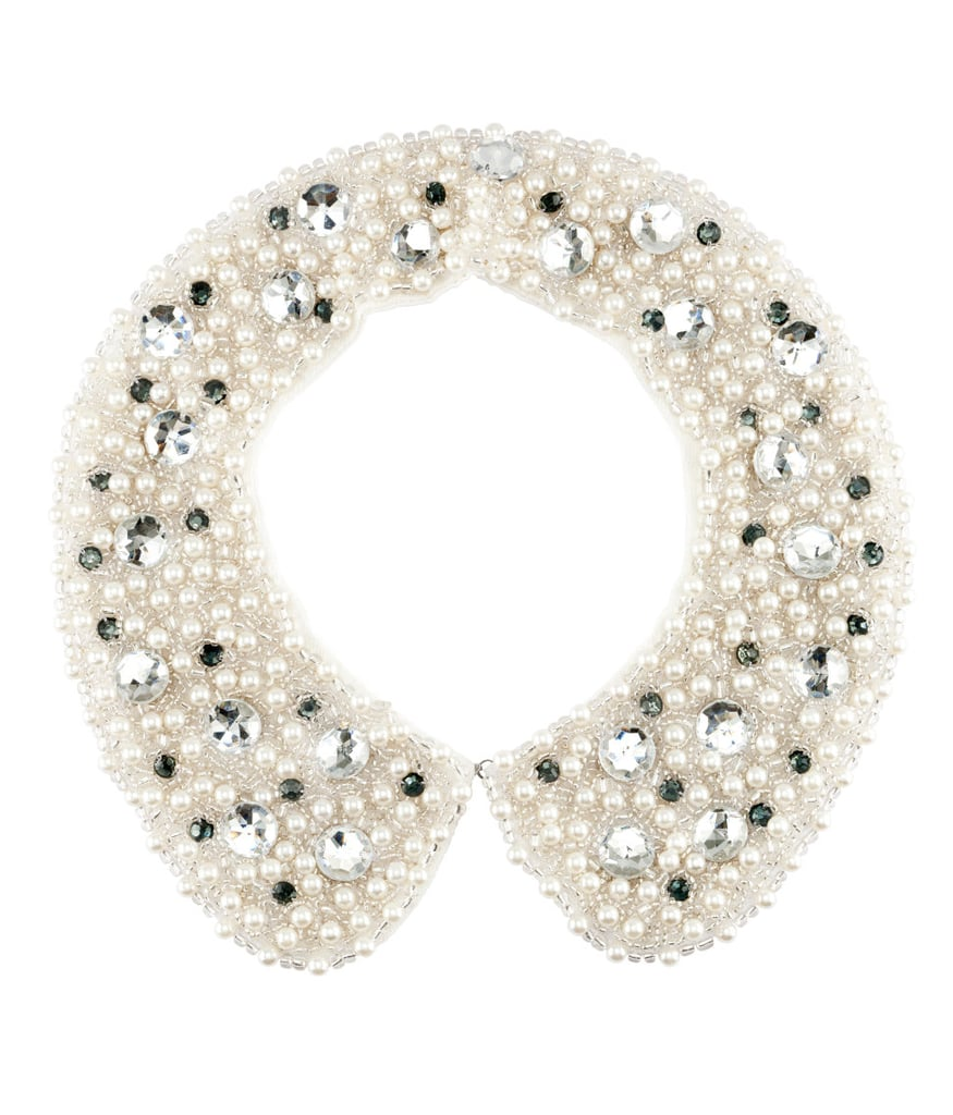 I love this  H&M collar necklace ($25). It's eye-catching, feminine, and plain 'ol pretty. Pair it with a button-up top for a stylish spin on a classic piece.  