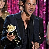 Taylor Lautner accepted an award on behalf of his Breaking Dawn costars.