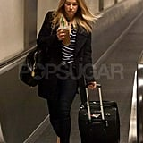 Lauren Conrad carrying her bags.
