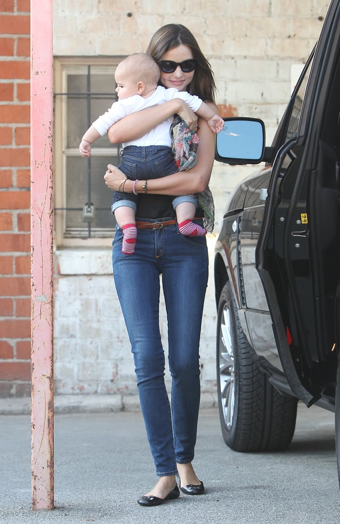 Flynn Bloom and Miranda Kerr wore matching denim pants.